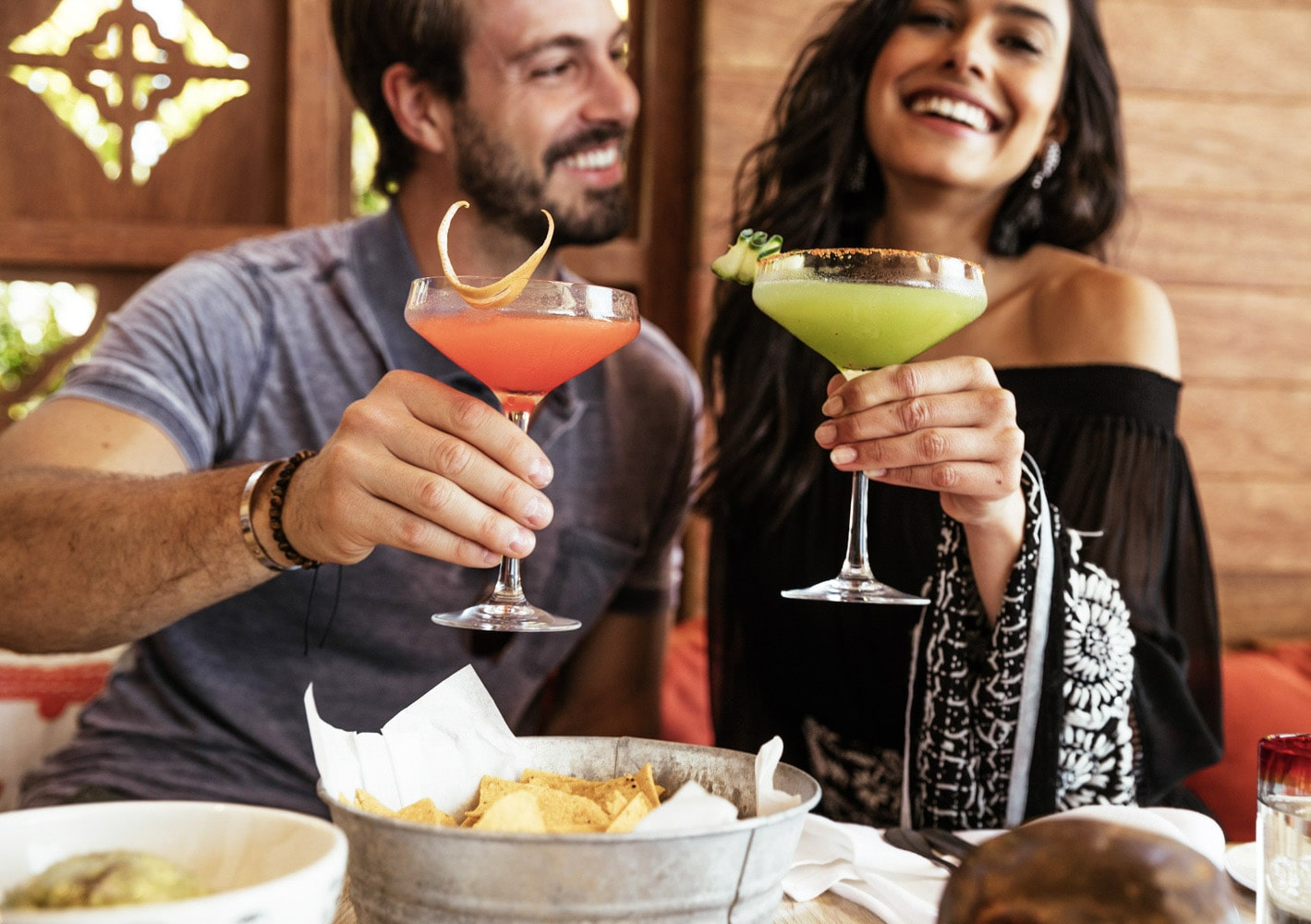 Dining with friends and family at Casa Calavera Los Cabos over authentic Mexican drinks.